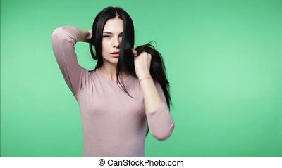 woman shaking the head demonstrating long hair