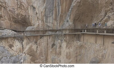 Tourists walking in 'El Caminito del Rey' - Walking in El...
