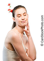 Naturaly beauty - Portrait of a young woman with red flower...