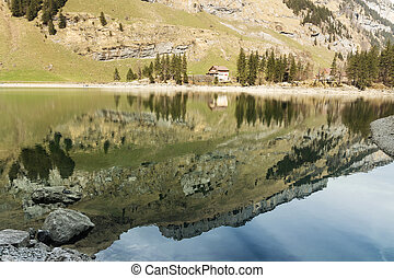 Tranquil scene of lake of seealpsee reflecting the mountain...