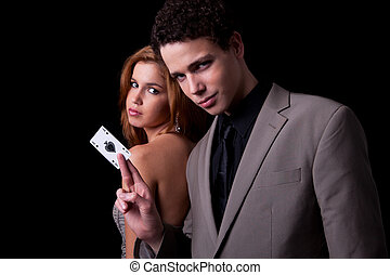 young couple, man holding a ace of spades, isolated on...