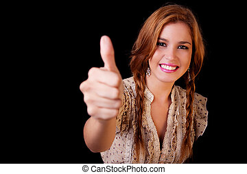 Young pretty women with thumb raised as a sign of success,...