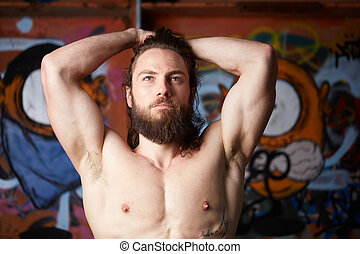 portrait of young bearded long haired man