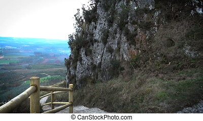Path and cave on the top of the Pico Sacro, a summit in the...