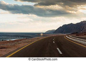 Asphalt road in desert Dahab, Egypt - Asphalt road in desert...