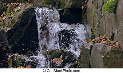 Waterfall detail slow motion - Waterfall panning through in...