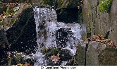 Waterfall detail slow motion - Waterfall panning through in...