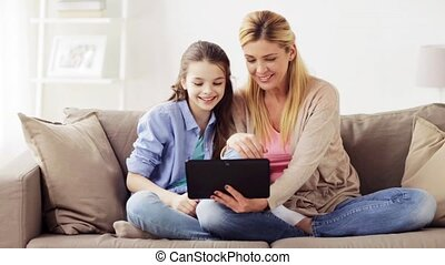 family with tablet pc having video chat at home - people,...