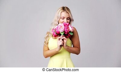 happy young woman with flowers - holidays and people concept...