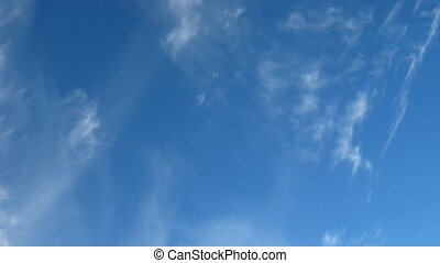 blue sky with moving fleecy clouds background