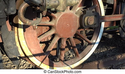 Detail of wheel on a steam locomotive placed in Carroponte...
