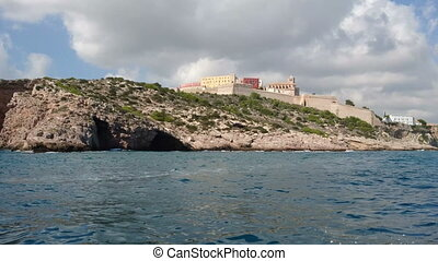 Ibiza old town seen from the sea from a boat navigating