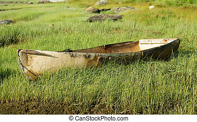 Old skiff - An old discarded fiberglass skiff on a grass...