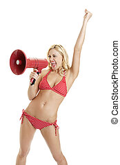 Excited hot young woman screaming into megaphone