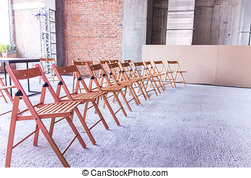 Some chairs. Several seats. Audience. Seminar. Lecture.