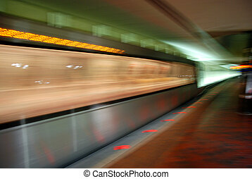 Blurred metro unit in motion