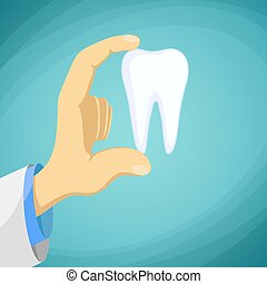 Doctor dentist holding a human tooth in his hand. Stock...