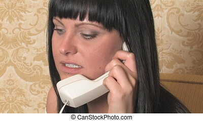 Young woman on phone with attitude.