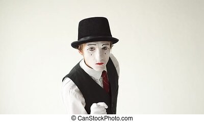 male MIME waving his fists on white background.