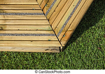 old wooden with green grass in the garden.