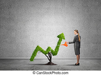 Make your money grow - Young attractive businesswoman...
