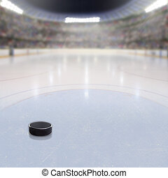 Hockey Puck on Ice of Crowded Arena - Hockey puck on ice in...