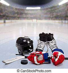 Hockey Equipment on Ice of Crowded Arena - Hockey helmet,...