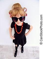 funny fashion-monger girl - Portrait of a pretty little girl...