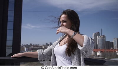 Woman adjusting hair at handrail - Young gorgeous woman...