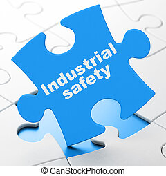 Construction concept: Industrial Safety on puzzle background