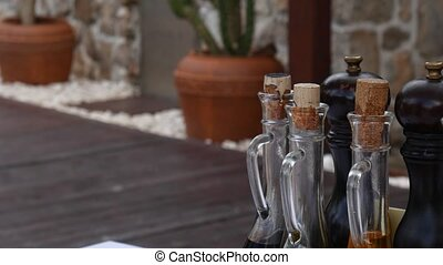 Bottles with seasonings in a fishing cafe in Montenegro....