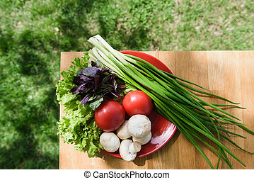 Healthy food fresh vegetables in plate on table