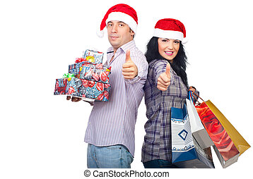 Successful happy couple with Christmas gifts