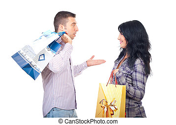 Couple with shopping bags having conversation