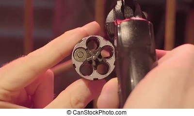 Male hand reload a revolver. Magnum gun without bullets ,...