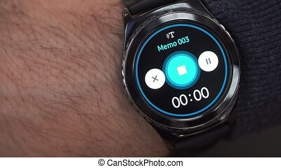 Closeup of a smart watch on male hand. The voice memo...