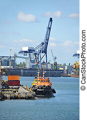 Tugboat and port cargo crane - Tugboat and crane in harbor...