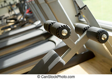 exercise equipment in fitness gym - closeup of exercise...
