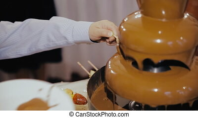 chocolate fountain, fruit dipped in chocolate.