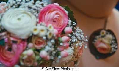 Rings lie on the Bridal bouquet