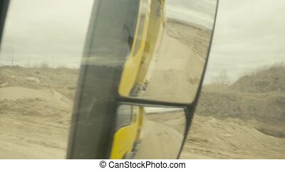 View in truck's rearview mirror on a quarry - Point of View...