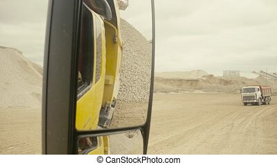 The work in the quarry shooting from the truck - The work in...