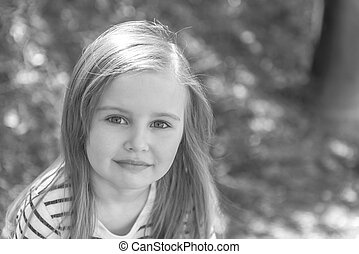 little girl with long hair, closeup, gray