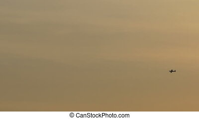 Small Plane Flying in Sunset - A small plane is passing the...