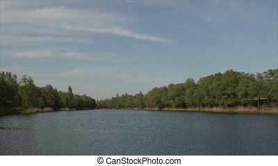 Lake in the daytime, wide angle - Waves on the lake