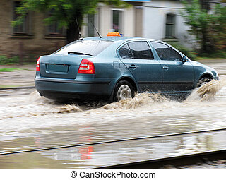 flood: a car moving over large puddle...