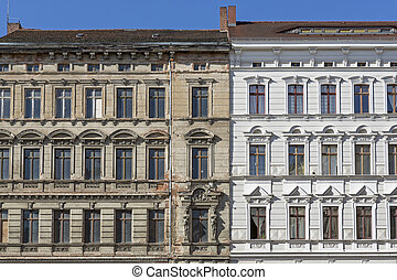 Unrenovated and renovated historic houses in the town of...