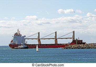 Vessel and Tugboat Entering Harbor in Durban - Large...