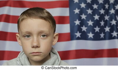 The boy's portrait against the background of the American...