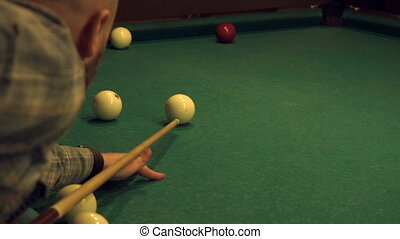young guy plays Russian Billiards in slow motion